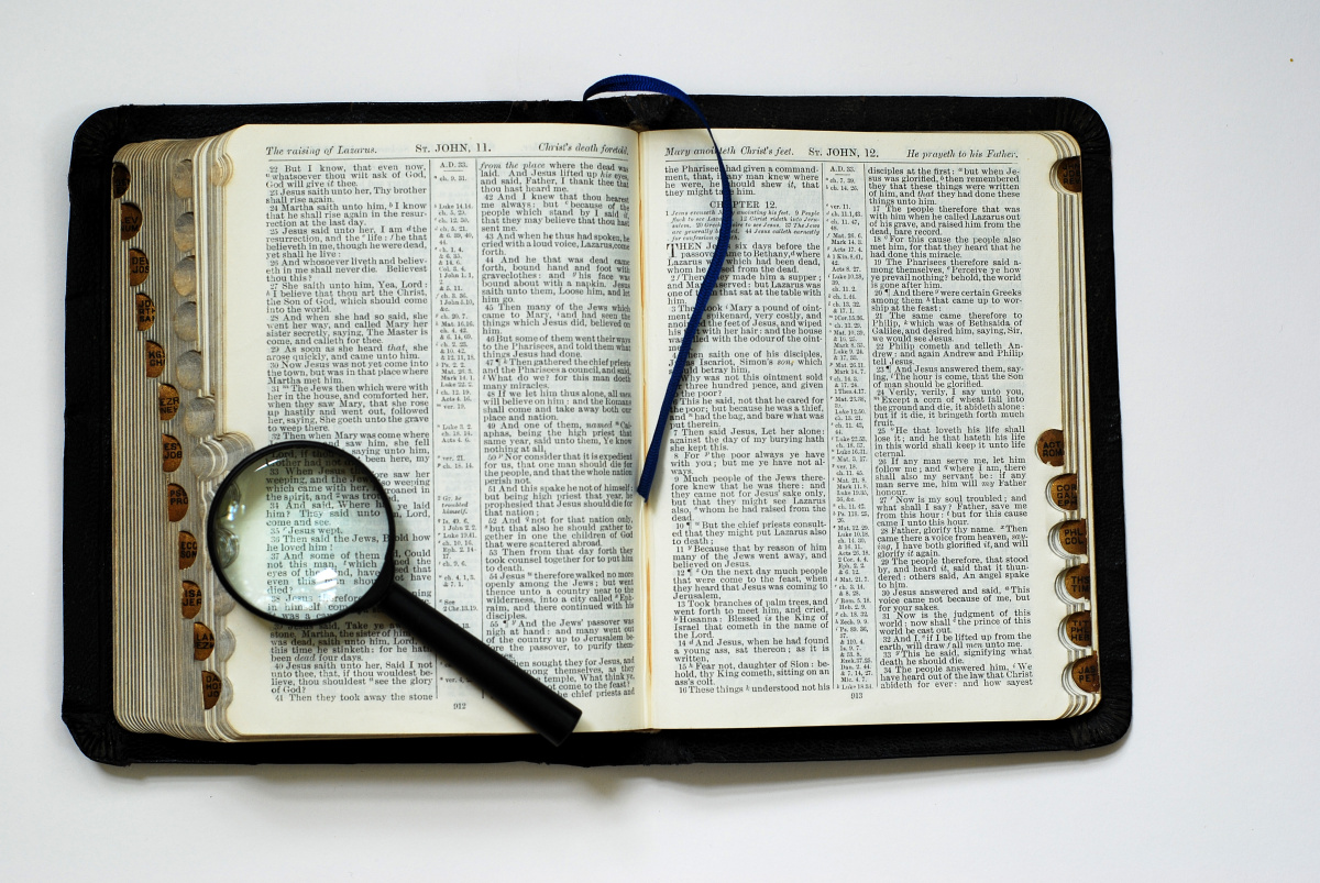 Image result for bible with magnifying glass
