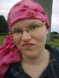Faded eyebrows... little hair... awesome headscarf.