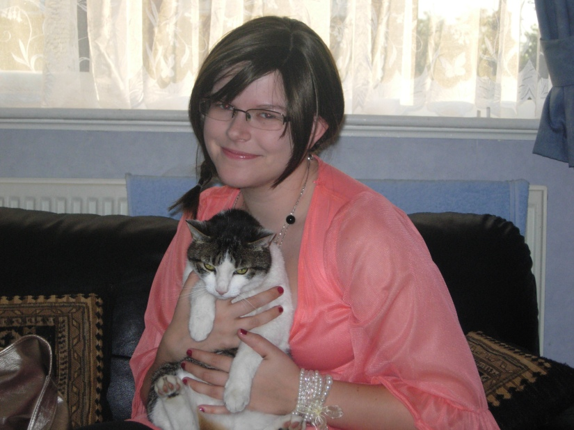 An old photo taken about 4 years ago with my cat Taffi and my wig (which didn't have a name). It was fun being a brunette.